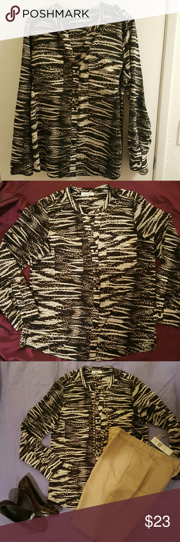 Calvin Klein animal print blouse, size large Browns and cream colored animal print blouse, to wear at work  and ready for after work. Two front pockets, sleeves roll up and cam be attached in place with attached strap and button. Calvin Klein Tops Blouses