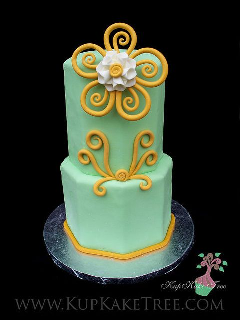 green & orange 2 tiered octagon cake by KupKake Tree, via Flickr