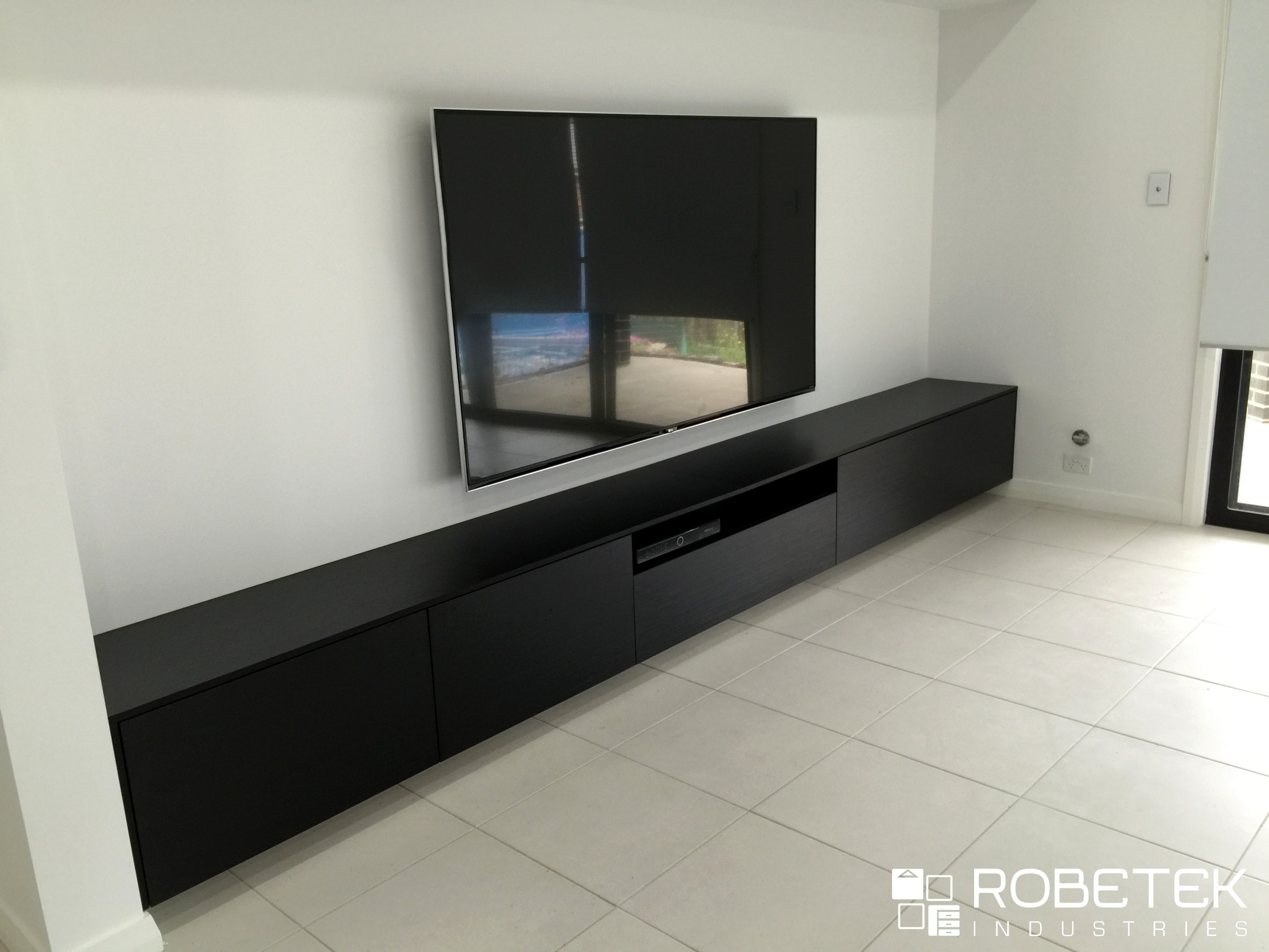 Custom Floating Tv Units This Floating Tv Unit Is A Stylish Statement That Is A Permanent Built In Solu Modern Tv Units Living Room Interior Black Tv Cabinet