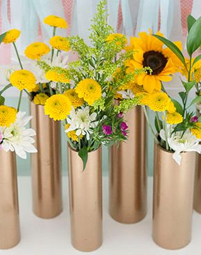 Make A Modern Spring Centerpiece Using Just Gold Spray Paint And PVC Pipe