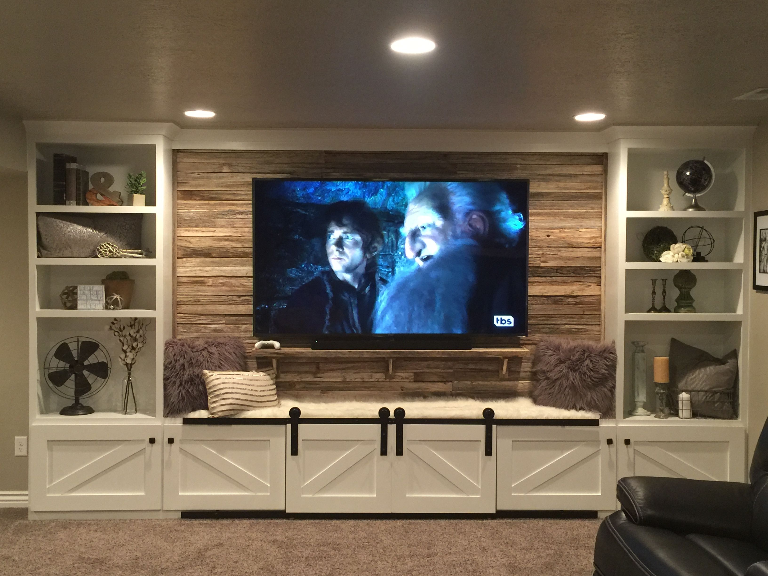 Our Hand Crafted Entertainment Center Built In With 75 Yr Old Reclaimed Wood Behind Living Room Entertainment Center Living Room Entertainment Basement Design