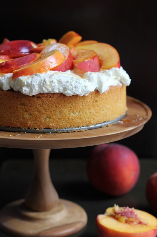 Olive Oil Honey Cake with Fresh Peaches. Olive Oil Honey Cake with fresh whipped cream, sliced peaches and lightly drizzled with honey!
