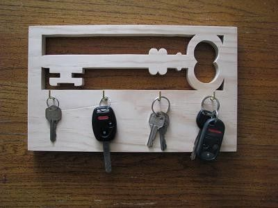 Unique decorative key rack. Made to represent an old skeleton key this piece is sure to draw peoples eye. Includes 4 key hooks and 2 d-ring hangers on back. Stain and seal is optional for an...