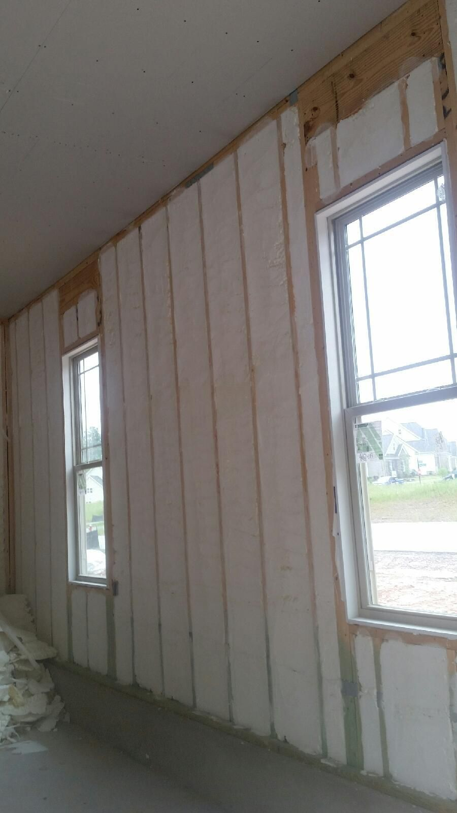 Spray Foam Insulation On The Exterior Walls Of A Town House