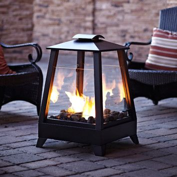 Real Flame Sonoma Outdoor Fireplace...perfect under the covered patio.  www.wayfair.com