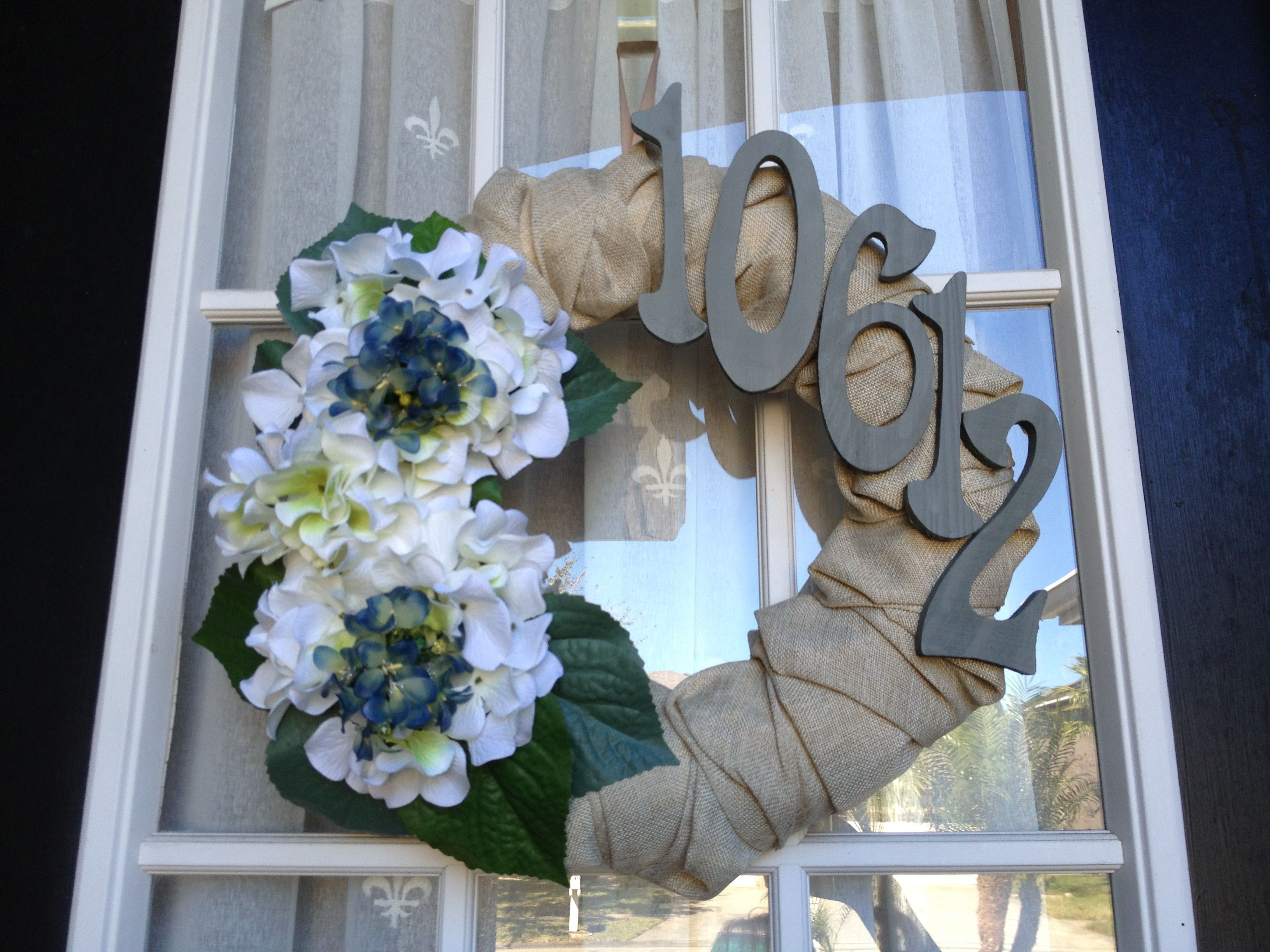 Used leftover house paint to paint numbers for perfect match. Hydrangea were our wedding flowers too. :)