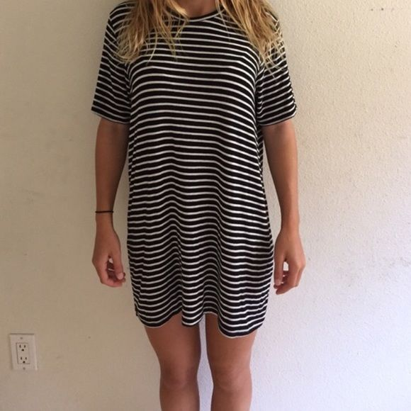 Brandy Melville stripped dress b&w OS Black and white brandy melville stripped t-shirt dress! GOOOOD condition but has been gently worn!! Brandy Melville Dresses Mini