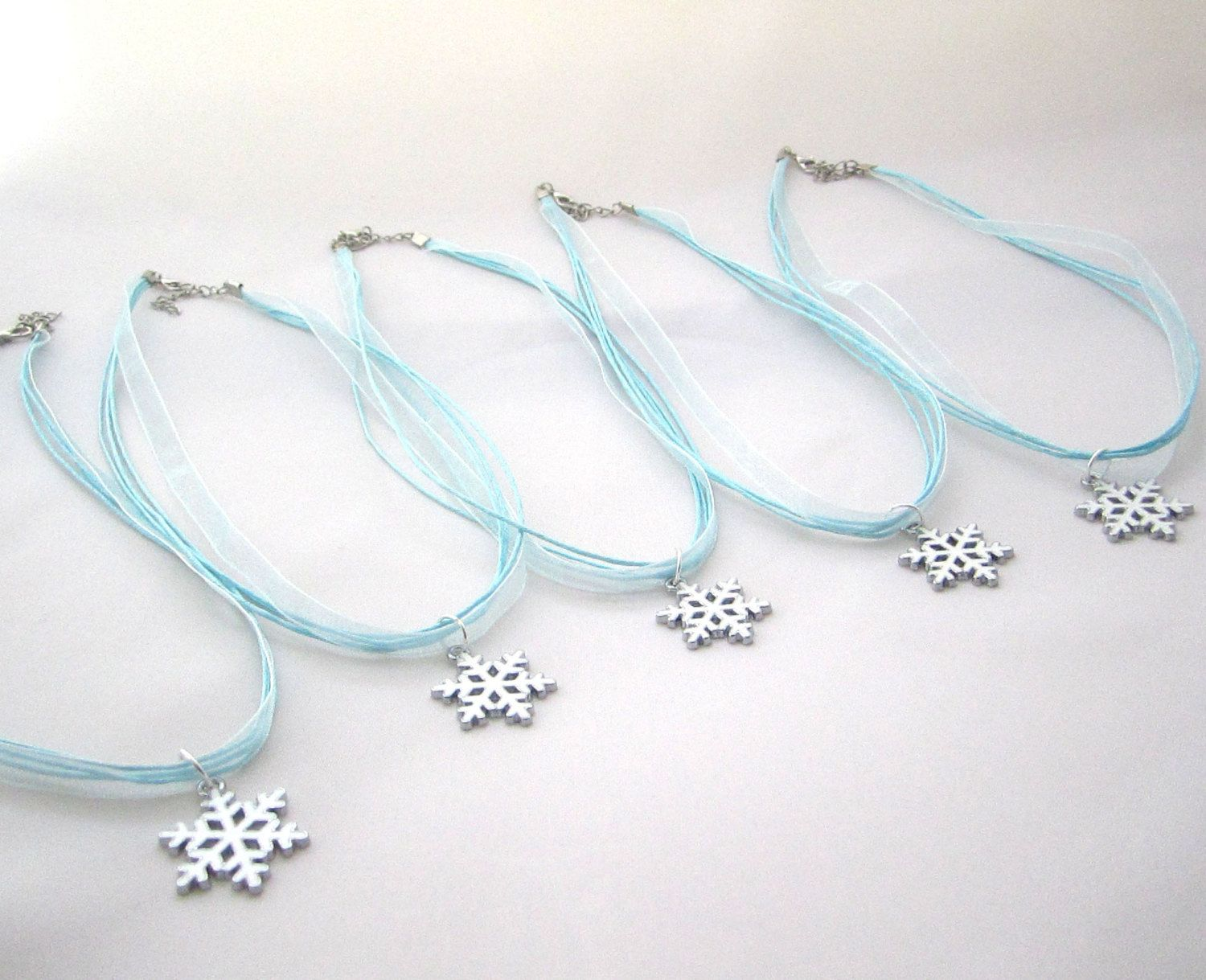 Set of 5 Snowflake Necklace Favors- Frozen Party Favors by FavorWrap on Etsy https://www.etsy.com/listing/195994403/set-of-5-snowflake-necklace-favors