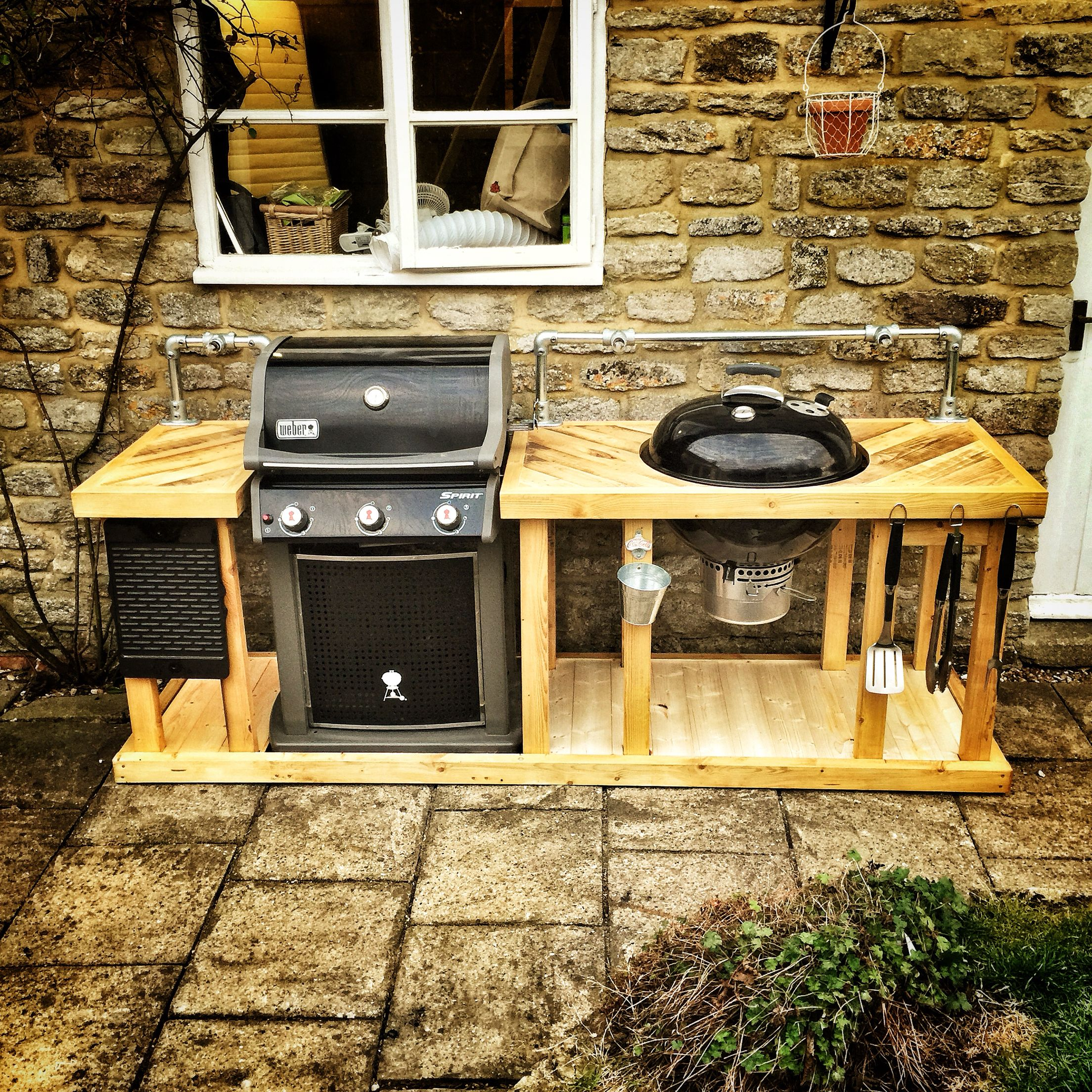 a weber mega grill combining a weber gas and charcoal bbq into an outdoor kitchen