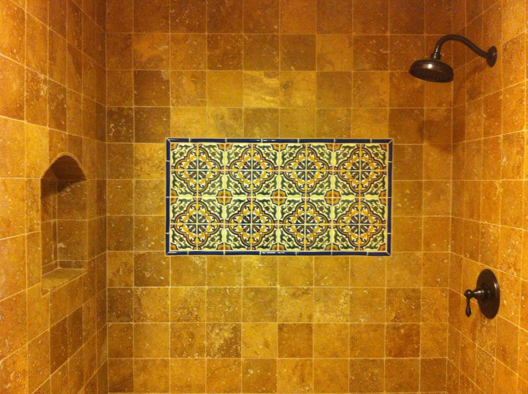 Tumbled travertines and Mexican decorative tiles make a nice ...