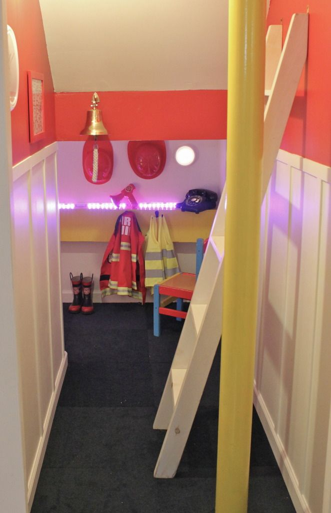 They built this in a unused space under the stairs in their basement so cool mini fire station - The fireman pole apartment an incendiary design ...