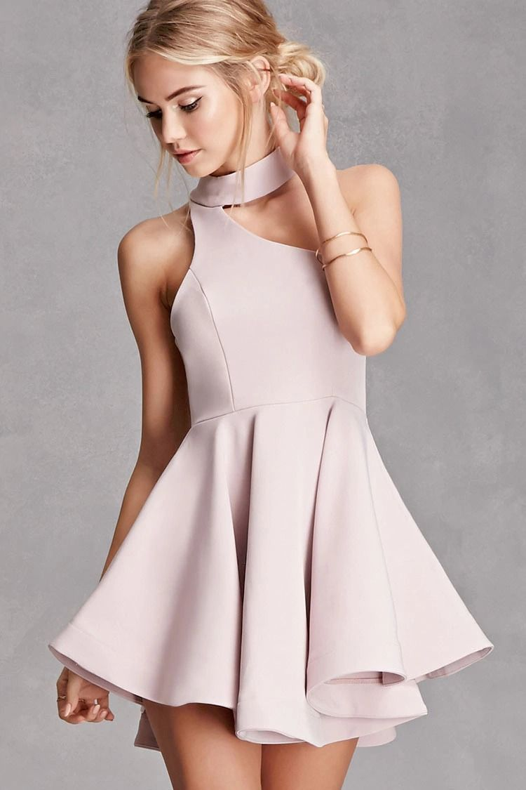 581f3065889 A woven fit and flare mini dress by Selfie Leslie™ featuring a mock neck  with a dual back button closure