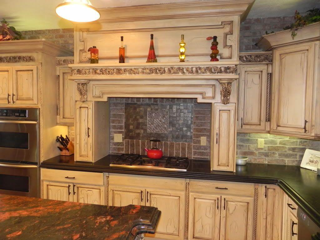Artistic Brick Backsplash Design In Kitchen With White Cabinet And Black Countertop Decor Idea