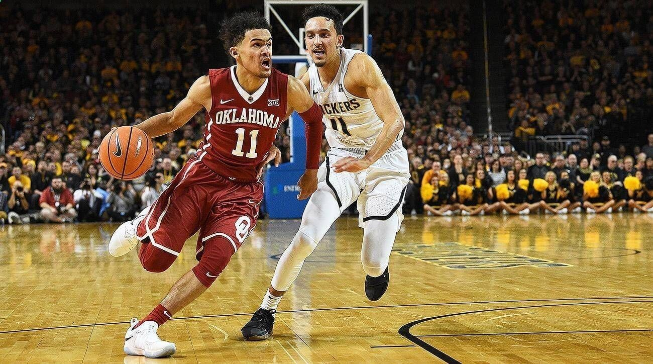 19 West Virginia holds off Trae Young
