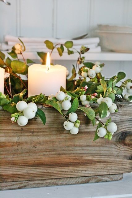 centerpieces: I like the idea of incorporating wood, plants/flowers, and candles. I would want some flowers in here instead of berries.