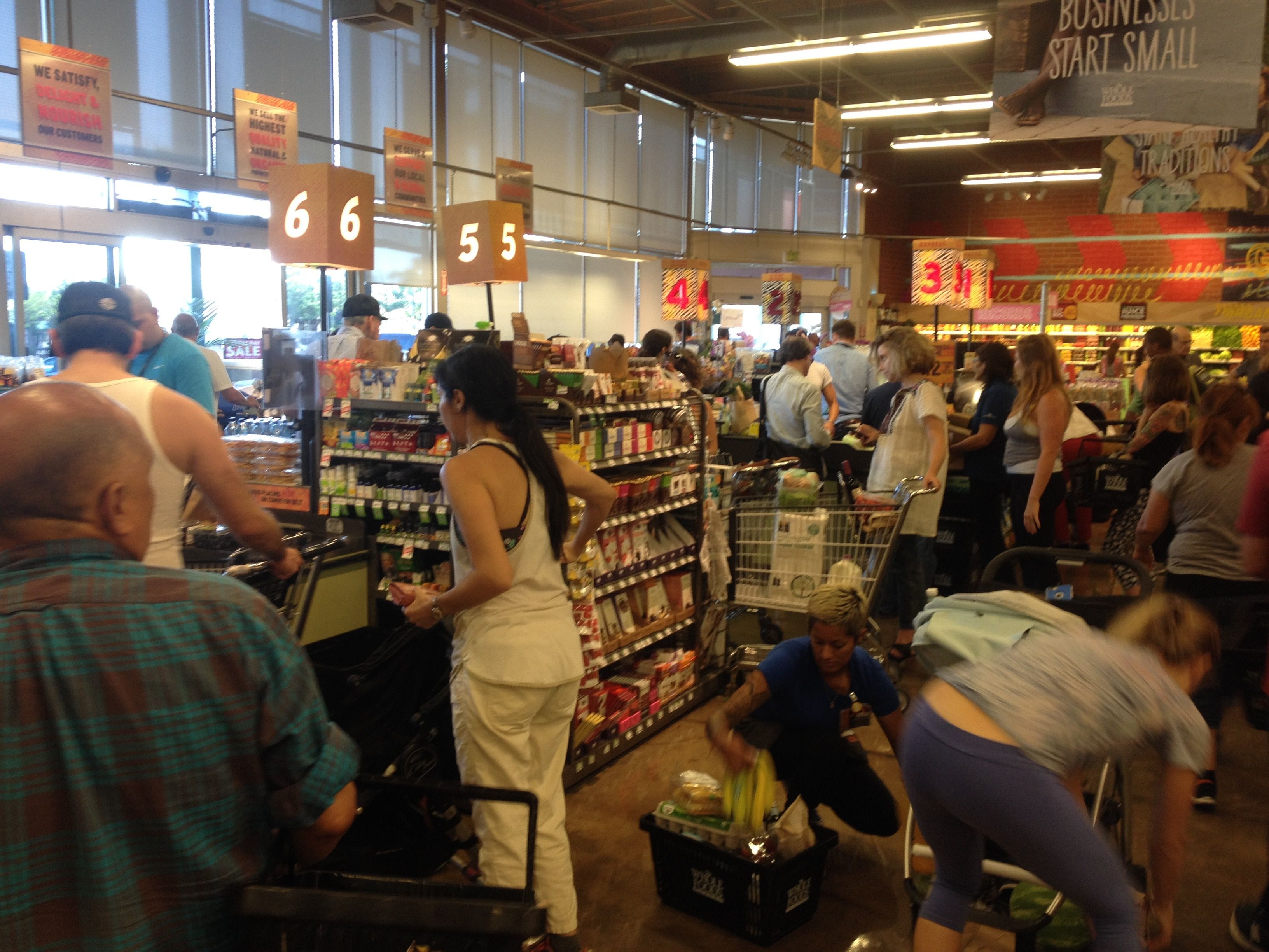 Busy day at whole foods the check out lines are backing
