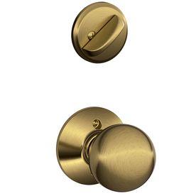 Schlage Orbit 1-3/8-in to 1-3/4-in Antique Brass Single Cylinder Knob Entry Door Interior Handles