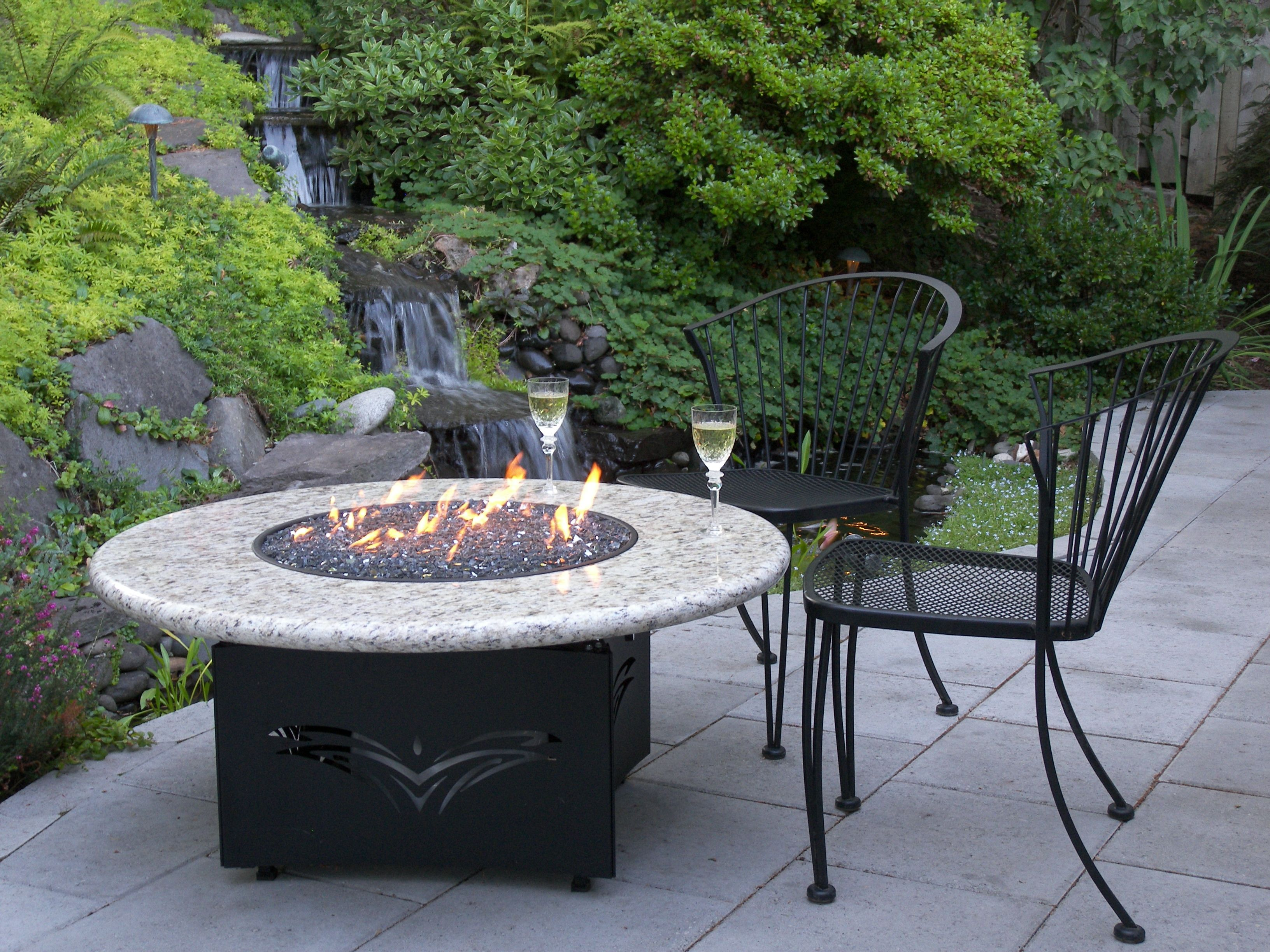 This Is The Oriflamme Fire Table With The Giallo Santo Granite Top