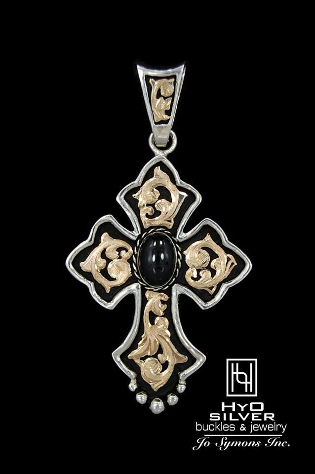 "With 4 stone colors to choose from, which RimRock stone would you choose? You'll love these large cross pendants! Wear with one of our 24 "" or 30"" chains for a bohemian look!  This large ""RimRock Budded Cross"", hand crafted from sterling silver and 10k and 14k gold overlay scroll detail, makes a grand statement! A 10 mm x 14 mm oval gemstone is bezel set in the center. Black antique background provides contrast to the bright silver and gold precious metals. #RRP002B, $450."