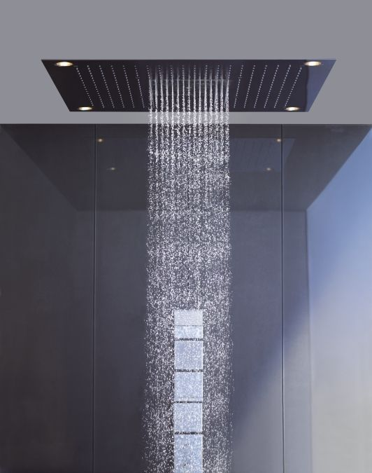 In This Modern Bathroom The Shower Has A Matte Black Rainfall Shower Head And A Hand Held Shower He With Images Bathroom Shower Tile Modern Bathroom Design Modern Bathroom