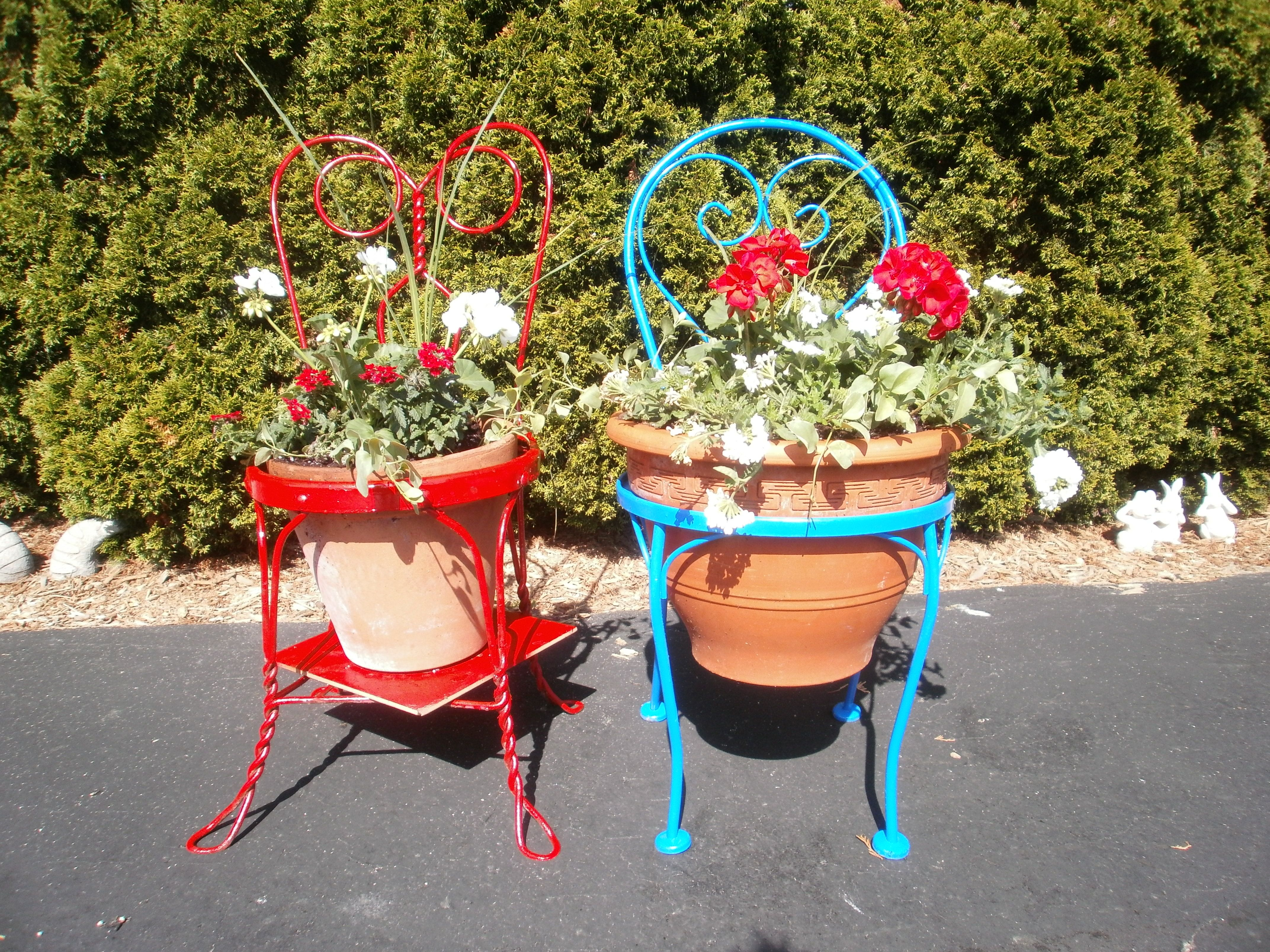 Painted old metal chairs and inserted planted flower pots.