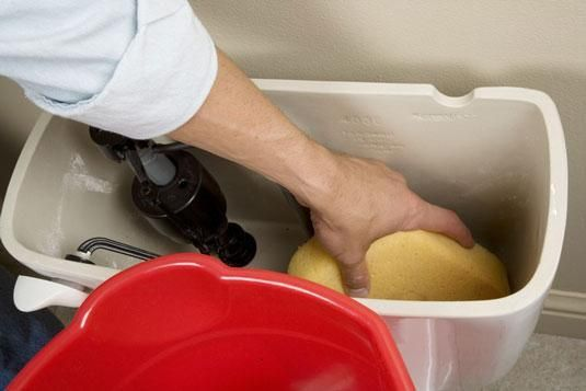 how to stop water leaking from toilet tank