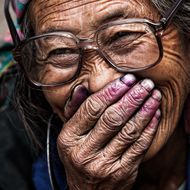 Old Hmong met in Mu Cang Chai (North Vietnam) Color on her hands is natural dye.