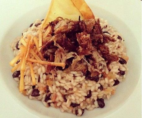 Black Bean Risotto from Gallo Pinto  http://www.chowzter.com/fast-feasts/latin-america/Santo%20Domingo/review/Gallo-Pinto/Black-Bean-Risotto/4748_4762
