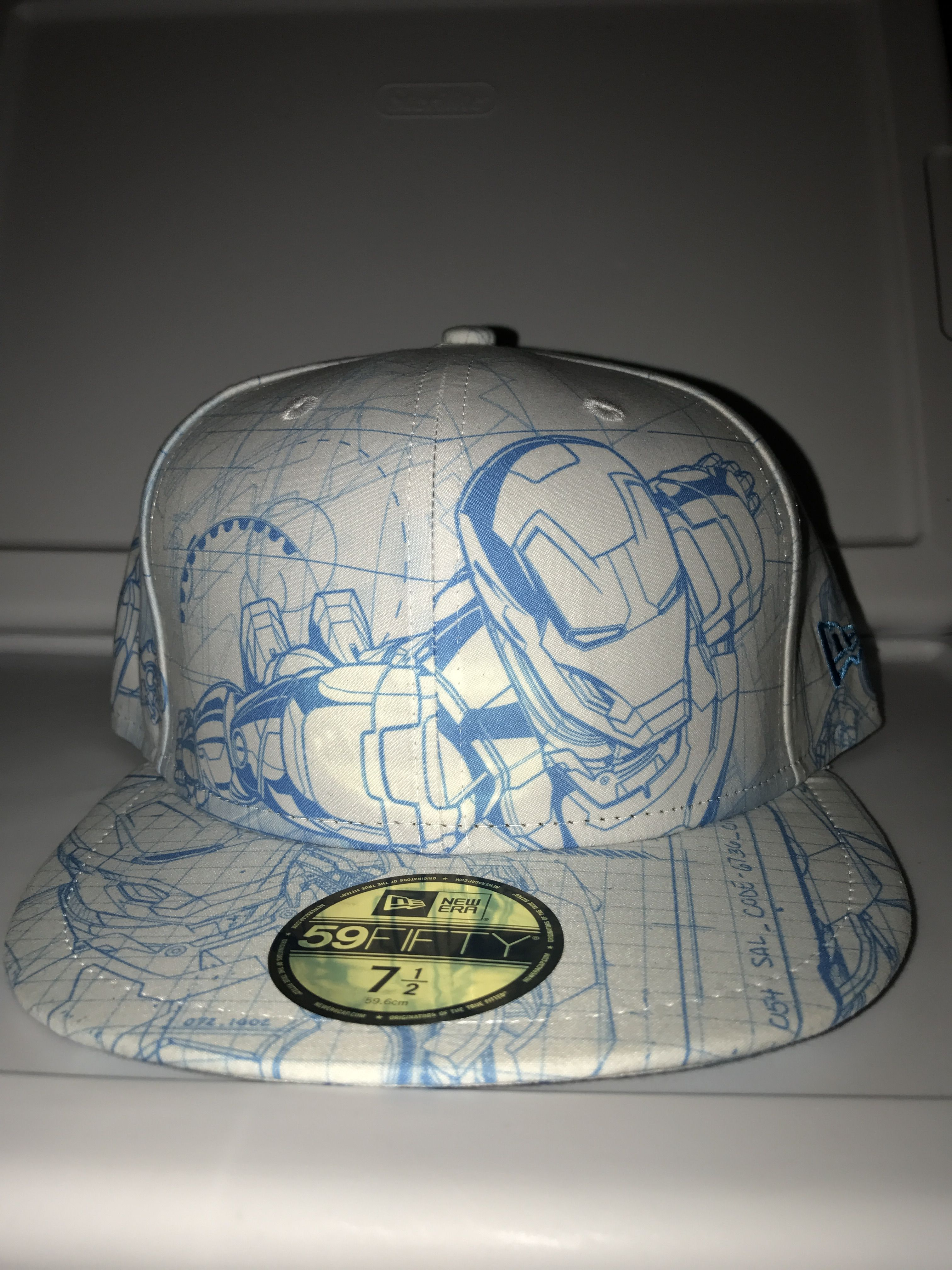 official photos 782a3 57e65 New era marvel Iron Man blueprint all over with Stark symbol on the back  fitted