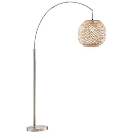 The Rattan Globe Shade Of This Sleek Steel Arc Floor Lamp Warms