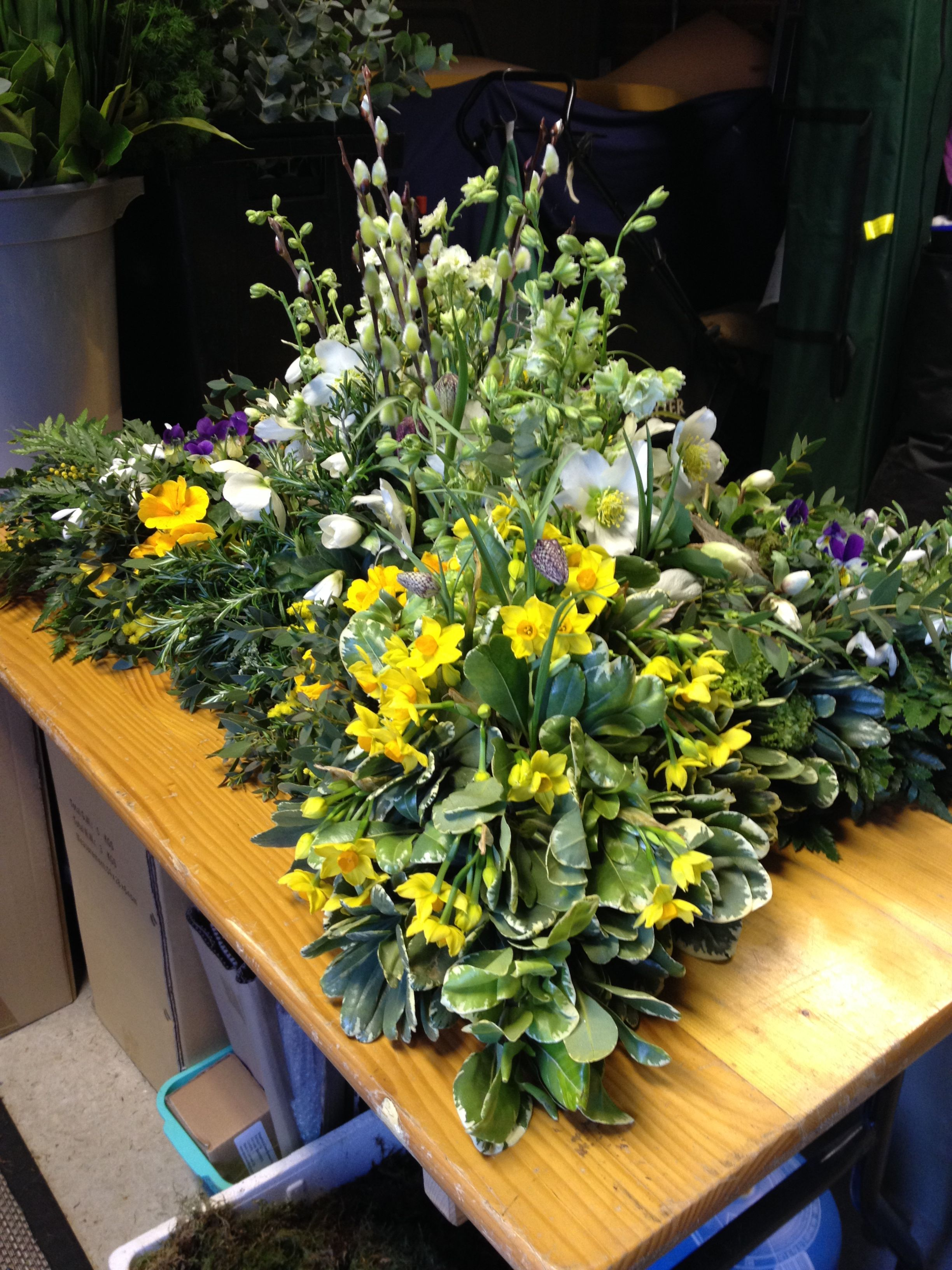 Garden inspired funeral flowers for a loved one by Wendy B