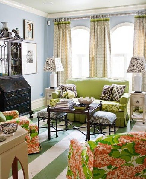 Another view of this funky cottage style room - Madcap Cottage. Love the striped painted floor, stools, ruffles, green and pink and that black piece. 2.24.2013