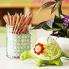 Turtle Tool  Get creative with your tools. Instead of using your typical boring pincushion, a stuffed green turtle that matches the room's bright color scheme helps bring the room to life.