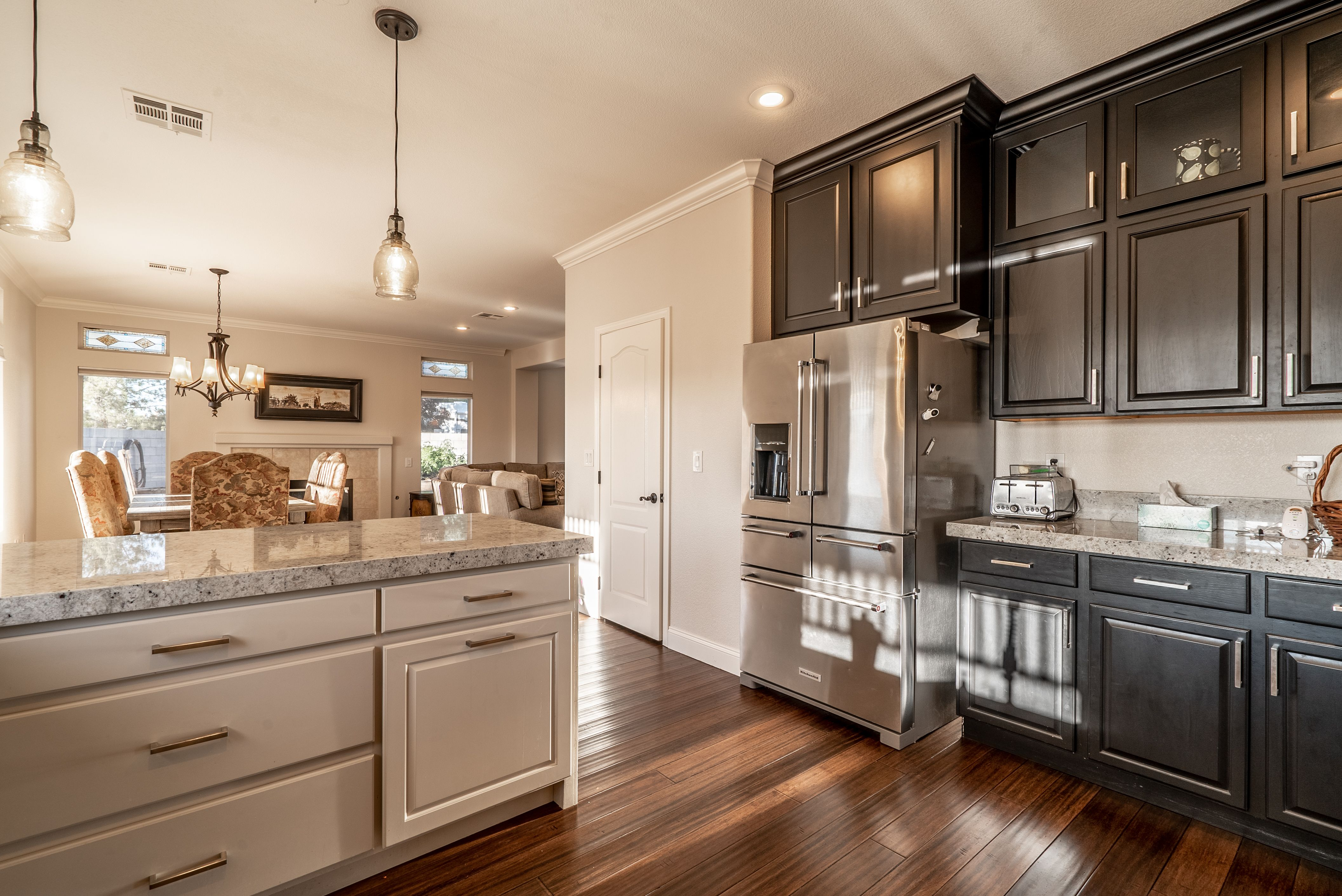 stacked upper cabinets granite countertops pendant lights black cabinets upper cabinets on kitchen cabinets upper id=81590