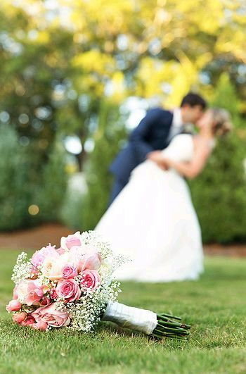 not quite this but something similar with the bouquet in the forefront <3