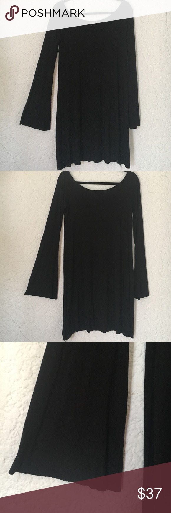 LaROK cotton jersey long bell sleeved dress Super soft jersey cotton dress with bell sleeves. Drapes really nicely. Can wear with tights and boots to dress it down or heels if you want to dress it up! LaRok Dresses Long Sleeve