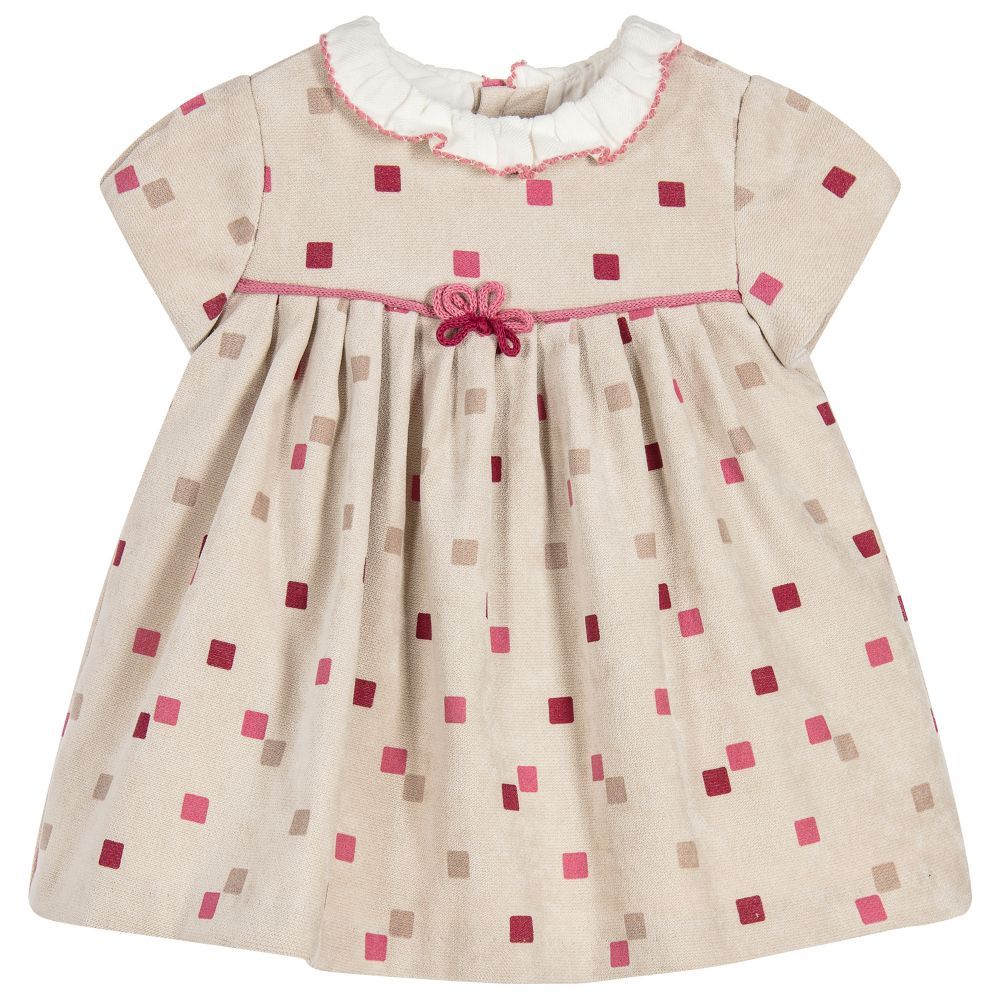 Baby girls will look adorable in this beige dress by Mayoral