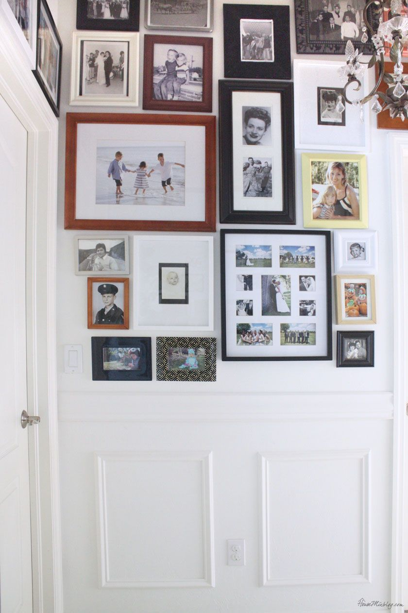 Photo gallery collage covers entire hallway with family photos of ...