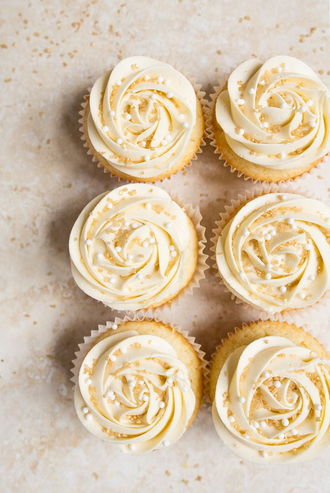 Almond wedding cake cupcakes with perfect white buttercream roses ...