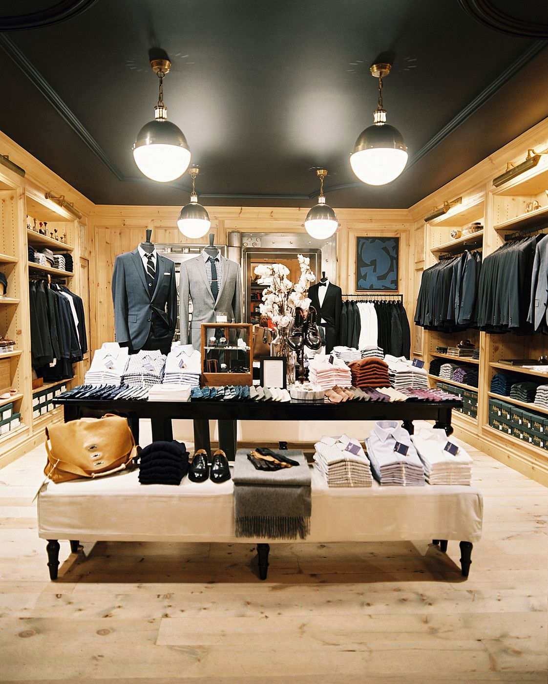 Rustic traditional retail store design clothing on display at the j crew mens shop