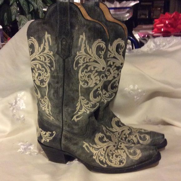 Grey & White Corral boots PRICE FIRM These boots are amazing! There is only one problem, I bought these beauties. But inside one boot is ripped, so it's not very easy to get on. I took to the boot repair, and they said $50- to fix. This is an easy repair and inexpensive to boot for these spends boots. Any Q's please ask!! Corral Boots Shoes Heeled Boots