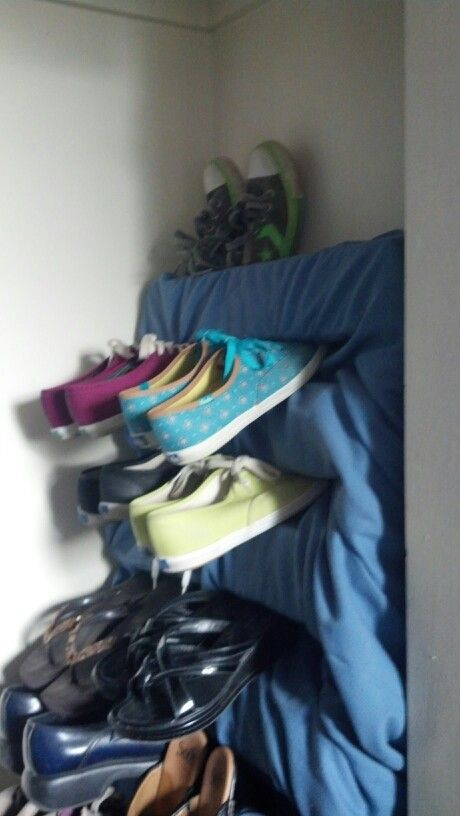 Half a pallet, covered w/ random fabric  holding my shoes!!