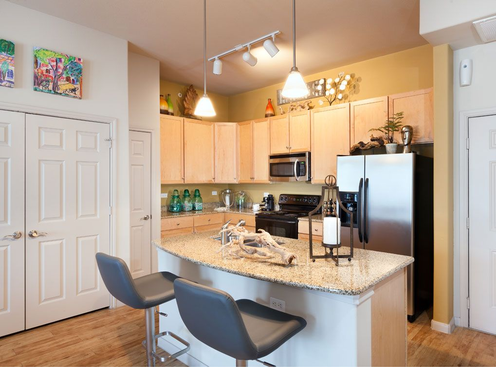 Fully Equipped Kitchen With Stainless Steel Appliances At AMLI A Luxury  Apartment Community In Downtown Austin.
