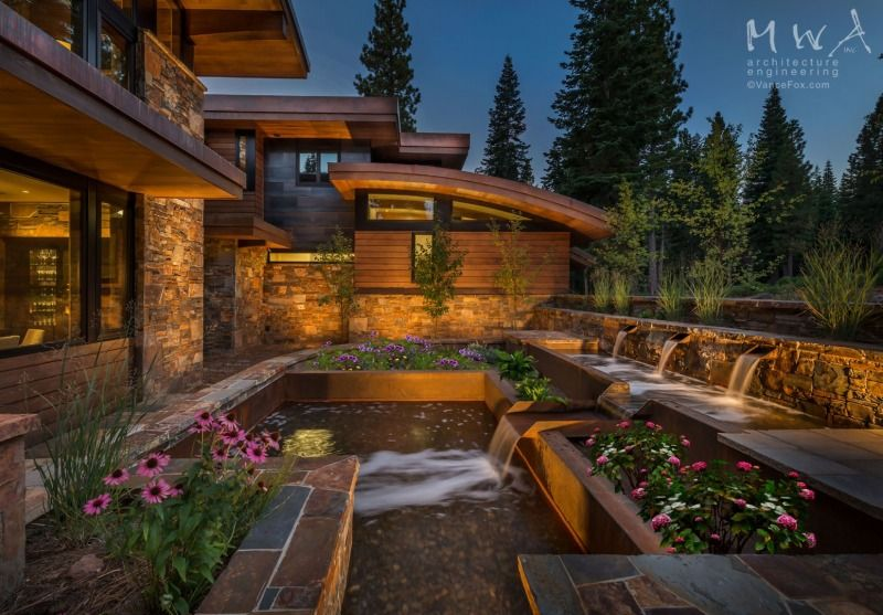 Modern dining and living room with backlit geode wall near ... on Outdoor Living Space Builders Near Me  id=57929