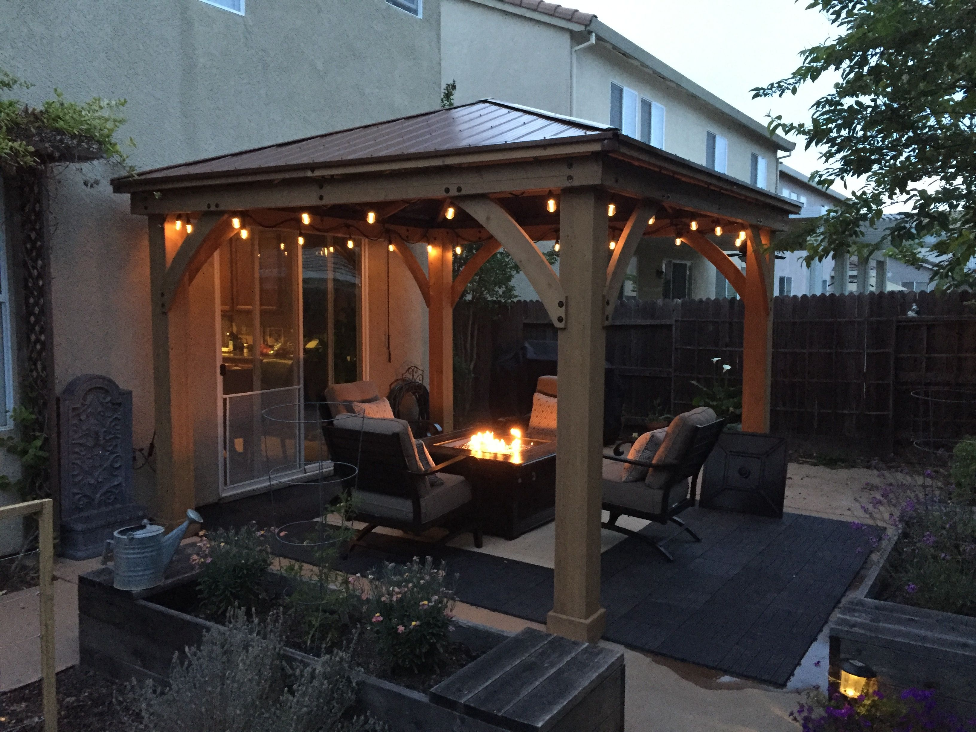 stunning gas fire pit beneath a covered patio of a seattle area