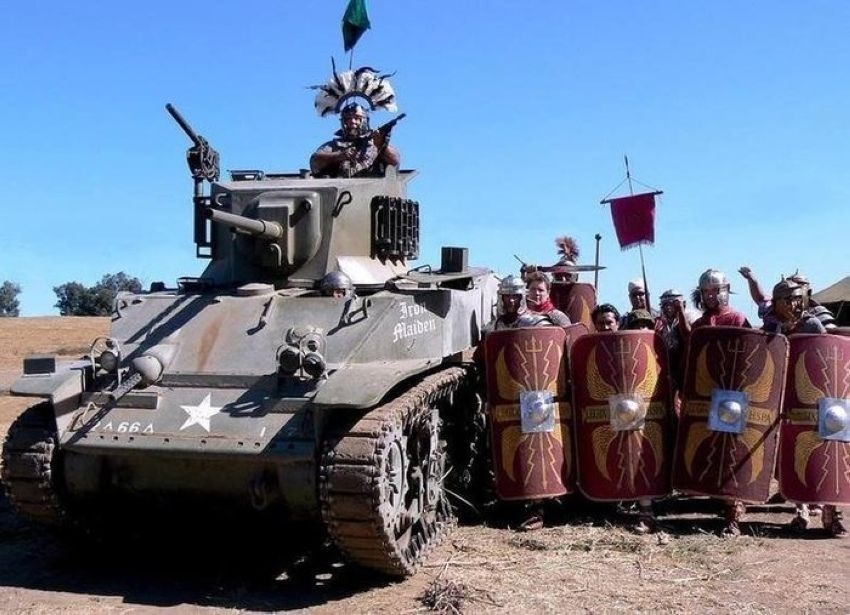 fe4b6799c247019b19ef73627a8481d7 roman soldiers with the support of an armored tank prepare to face
