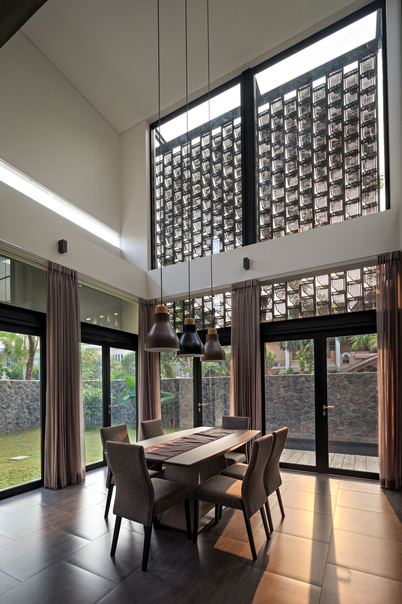 Dining room of happy house design by modernspace yanto for House interior design jakarta