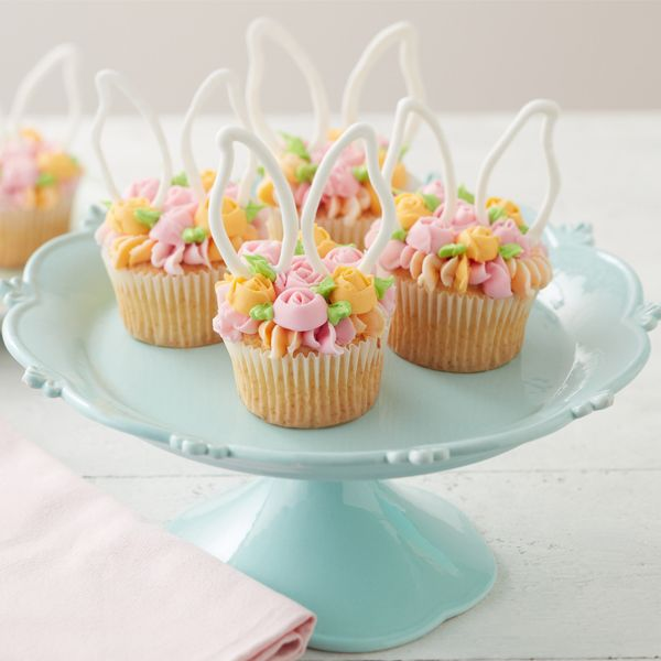 How to Make Blooming Easter Cupcakes - Spring cupcakes, Easter baking, Easter dessert, Easter cupcakes, Easter cakes, Easy easter desserts - Looking for beautiful yet simple Easter cupcake ideas to make this year  Look no further than these Blooming Easter Cupcakes  Topped with simple piped flowers and bunny ears, these Easter cupcakes are a spring floral fantasy!