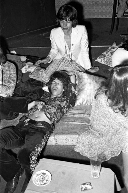 Mick Jagger and Keith Richards (snoozing) at Mick's wedding to Bianca Pérez-Mora Macias in St. Tropez, 1971