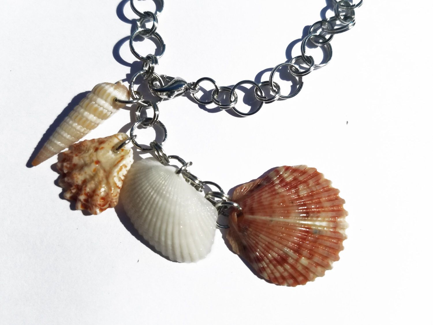 Natural Seashell Combination Bracelet by SeaCasual on Etsy https://www.etsy.com/listing/467928663/natural-seashell-combination-bracelet